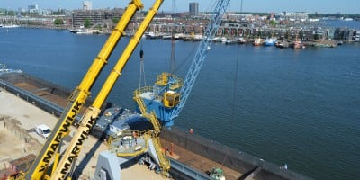 Moving and adapting grapple-top-rotating crane for Albeton